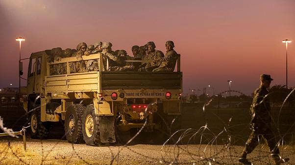Image: Troops enter a compound near the U.S.-Mexico border crossing at Donn