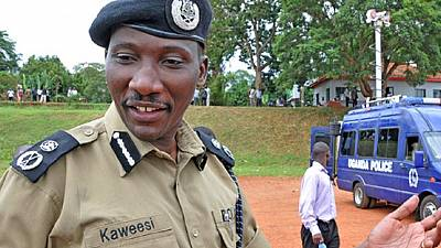 Thirteen charged in Uganda over murder of top policeman