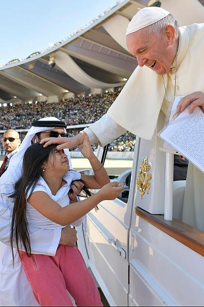Pope Francis blesses a child before celebrating Mass in Abu Dhabi on Tuesday.