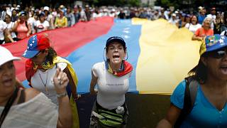 'There is no future here' - Venezuelans stage mass sit-ins