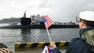 US submarine arrives in South Korea as the North carries out a huge live fire drill
