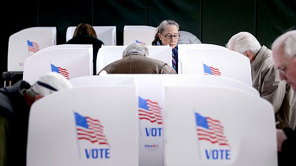 Image: People cast their ballots at a community center during early voting