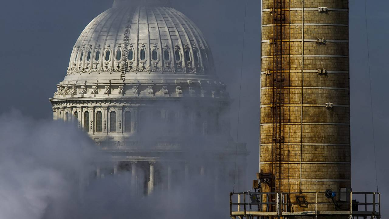 Image: The dome of the U.S. Capitol is seen behind the emissions, and a smo