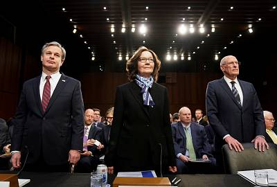 FBI Director Christopher Wray, CIA Director Gina Haspel and Director of National Intelligence Dan Coats arrive to testify before a Senate Intelligence Committee hearing on Capitol Hill on Jan. 29, 2019.