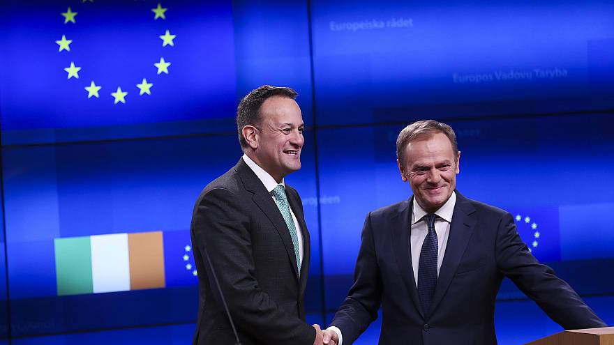 Image: Irish Prime Minister Leo Varadkar, left, shakes hands with European