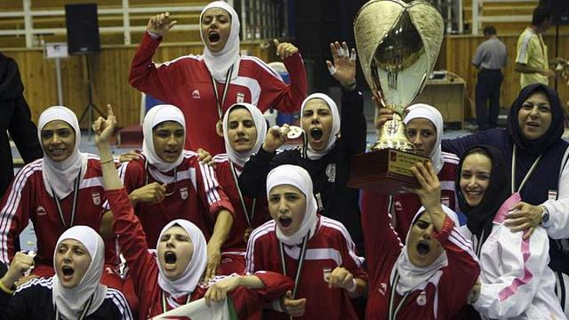"""Iranian footballer """"banned from national team"""" for playing abroad without hijab"""