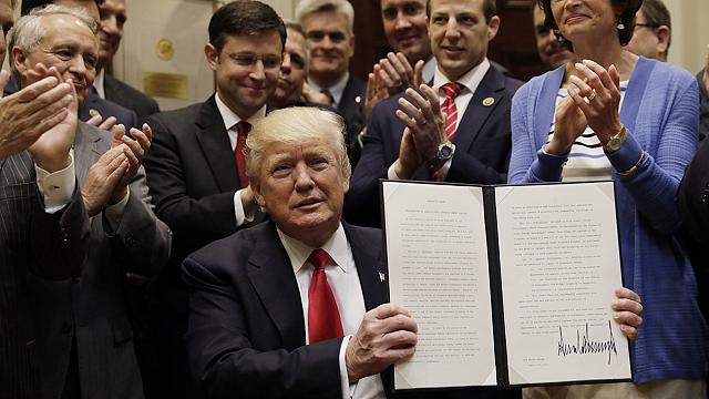 We're opening it up', says Trump of executive order