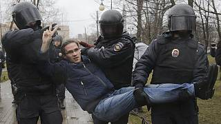 Dozens feared detained after 'sick of Putin' protests