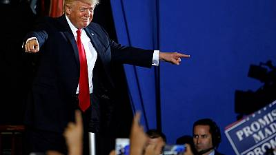 Trump attacks US media at 100-day rally