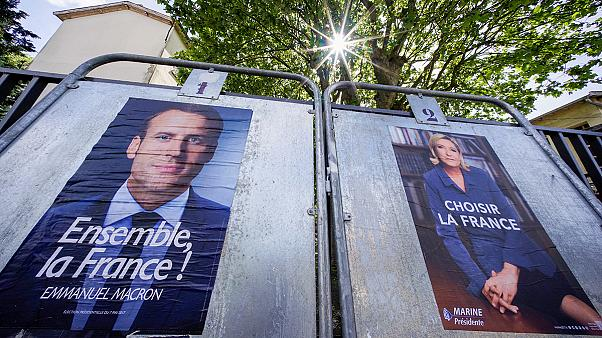 French election countdown: Macron 'ahead' but Le Pen fights on