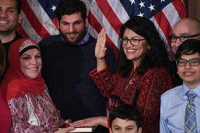 Rep. Rashida Tlaib wears a traditional Palestinian robe as she takes the the oath of office at the U.S. Capitol on Jan. 3.