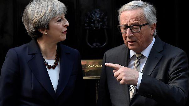 """May diz que """"ceticismo"""" de Juncker face ao """"Brexit"""" é """"boato de Bruxelas"""""""
