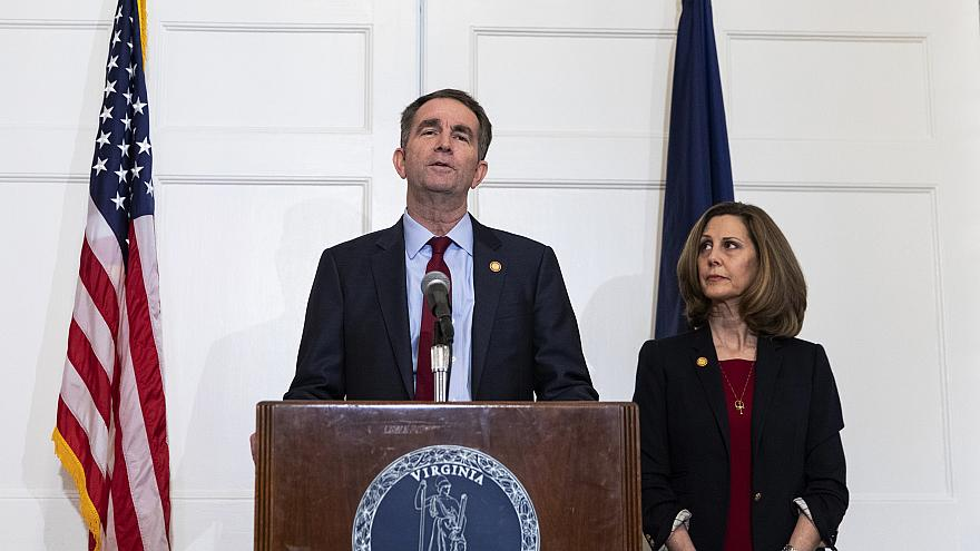 Virginia Governor Ralph Northam speaks with reporters at the Governor's man