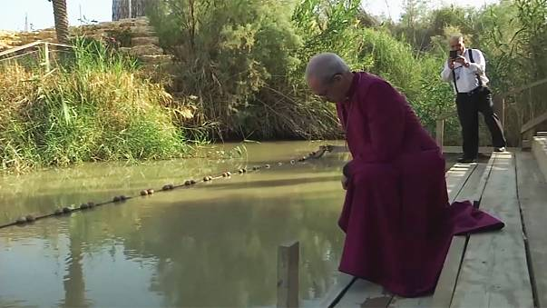 Archbishop of Canterbury prays at River Jordan
