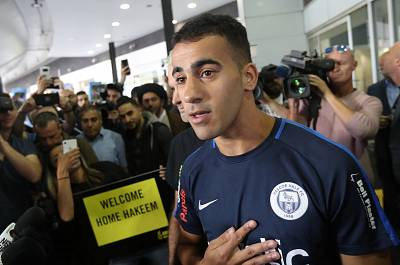 Hakeem Al-Araibi arrives at Melbourne International Airport in Melbourne, Australia, on Tuesday.