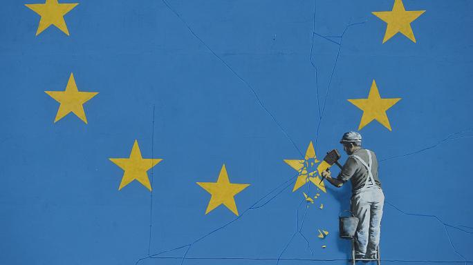 Banksy shows workman removing star from EU flag