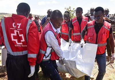 Members of the Kenya Red Cross carry victims\' bodies after a light plane crashed in a field in Kericho county west of the capital Nairobi on Feb. 13, 2019.