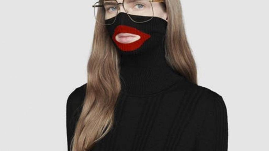 Image: An online fashion outlet showing a Gucci turtleneck black wool balac
