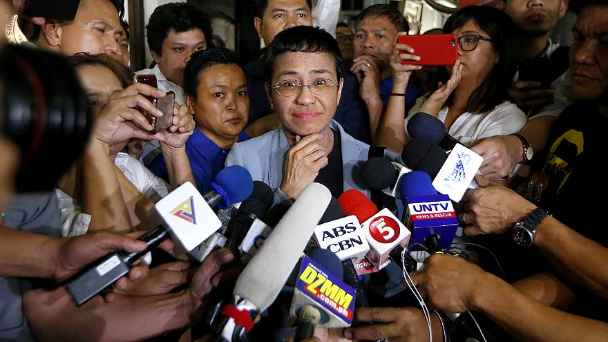 Image: Maria Ressa, center, the award-winning head of a Philippine online n