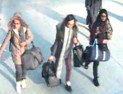 British teenagers Amira Abase, Kadiza Sultana and Shamima Begum walking with luggage at Gatwick Airport, south of London, on Feb. 17, 2015.