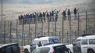 About 300 African migrants storm border fence, 100 cross into Spain