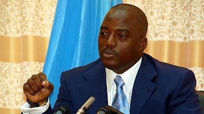 Kabila names DR Congo's transitional government despite resistance