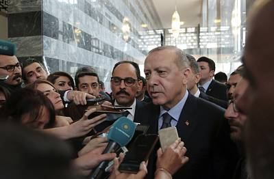 Turkey\'s President Recep Tayyip Erdogan speaks to the media at the parliament in Ankara on Jan. 8, 2019.