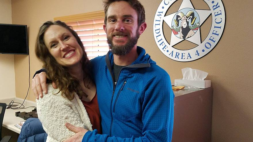 Image: Annie Bierbouer and Travis Kauffman embrace before a press conferenc