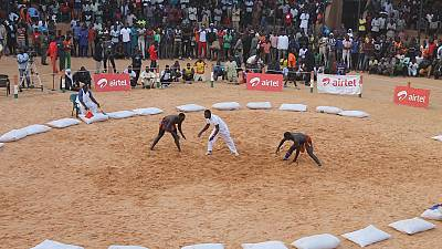 West African traditional wrestlers lock horns in Senegal's capital