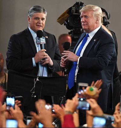 Fox News Channel and radio talk show host Sean Hannity, left, interviews President Donald Trump before a campaign rally at the Las Vegas Convention Center on Sept. 20, 2018.