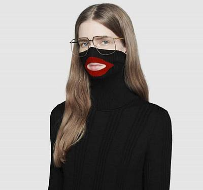 An online fashion outlet showing a Gucci turtleneck black wool balaclava sweater for sale, that they recently pulled from its online and physical stores.
