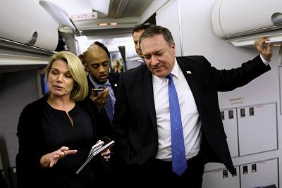 Spokesperson Heather Nauert, from left, speaks as Secretary of State Mike Pompeo holds a dialogue with reporters in his plane while flying from Panama to Mexico on October 18, 2018.