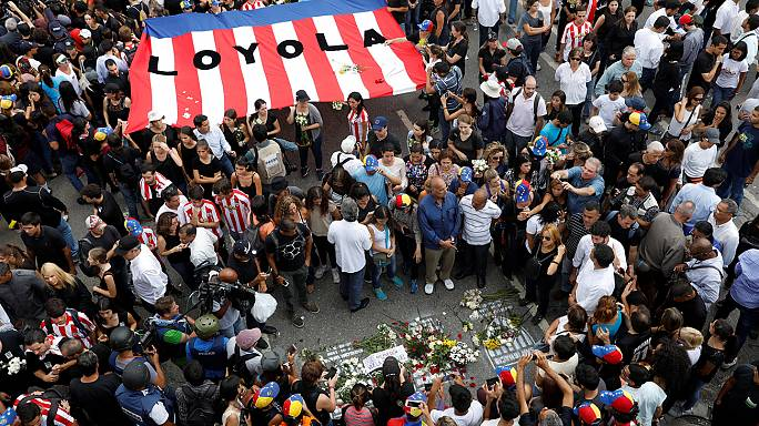 Marchers condemn latest death in Venezuelan protests