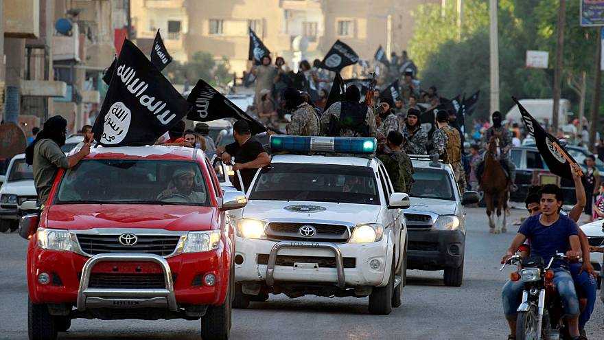 Image: FILE PHOTO -  Militant Islamist fighters waving flags, travel in veh