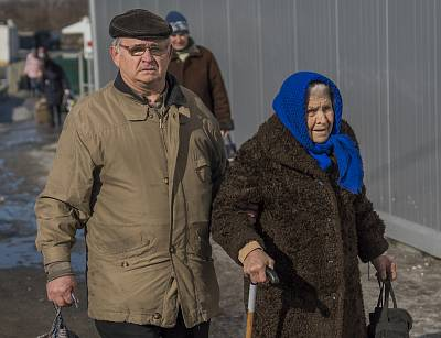 Retirees living in separatist territory must cross the frontline every month to collect their pension checks.