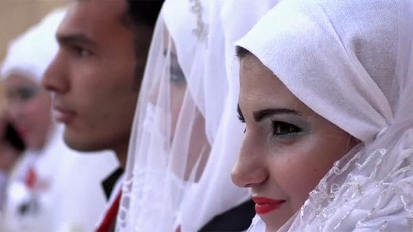 30 couples celebrate simultaneous wedding in Aleppo