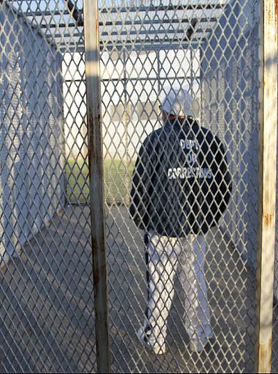 An inmate in a Special Management Unit recreation cage.