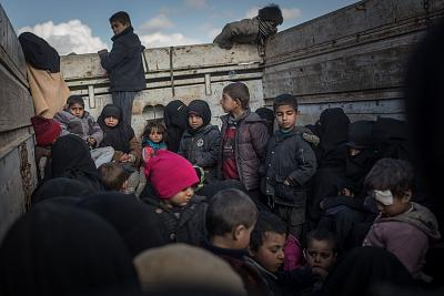 Children are transported to a refugee camp after leaving Bagouz, Syria, on Feb. 11. Bagouz is ISIS\' last stronghold.