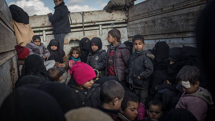 Image: Children are transported to a refugee camp after leaving Bagouz, Syr