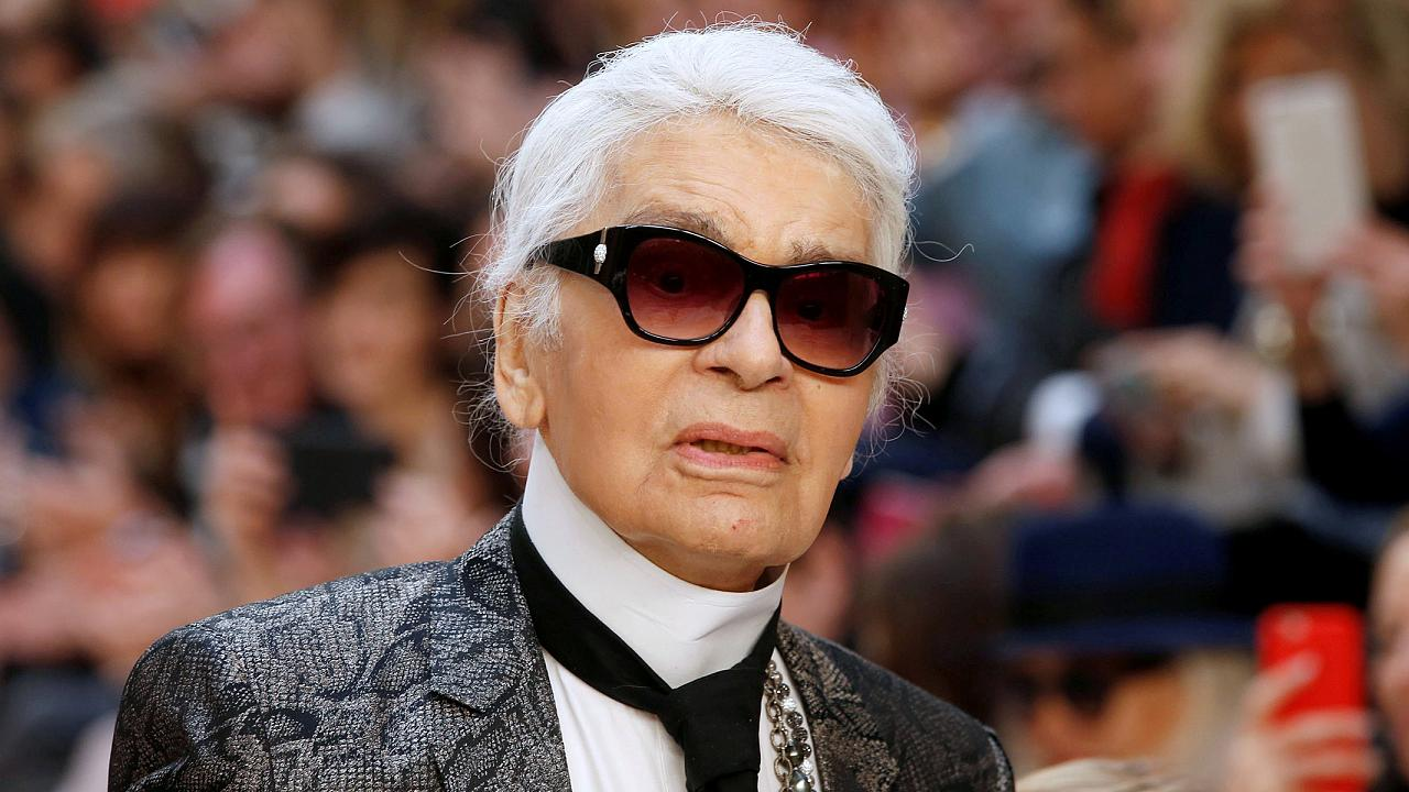 Image: FILE PHOTO - German designer Karl Lagerfeld appears at the end of hi