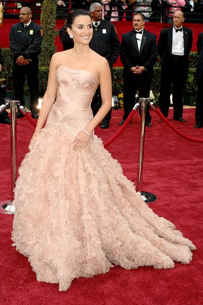 Penelope Cruz defining red carpet glamour in her Versace gown in 2007.