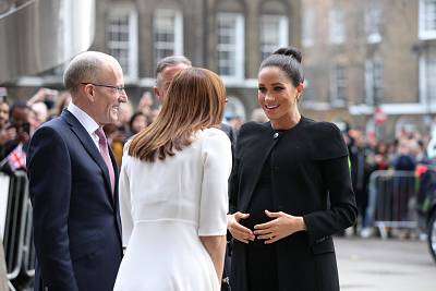 A glowing Duchess of Sussex arrives for at a London event on Jan. 31.