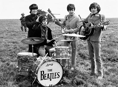 John Lennon, Ringo Starr, Paul McCartney and George Harrison on Salisbury Plain during the filming of \'Help\', March 5, 1965.