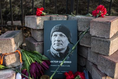A photograph of Viktor Orlenko is displayed at a makeshift memorial to protesters killed during the Maidan protests in 2014.