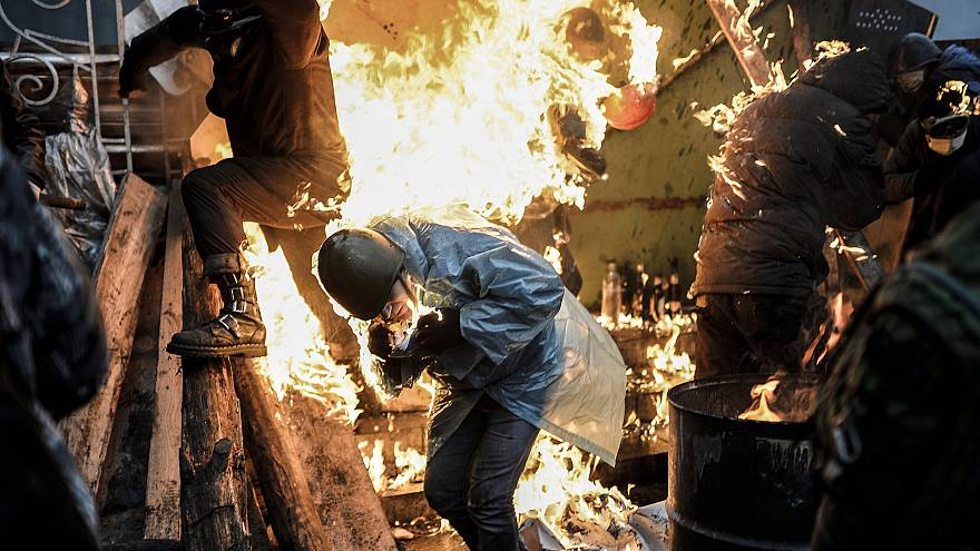 Image: Protesters during clashes with police in Kiev in 2014