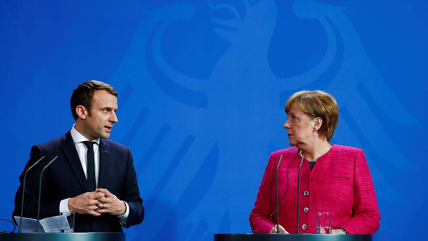 Macron meets Merkel in first overseas visit
