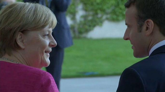 Macron e Merkel em Berlim