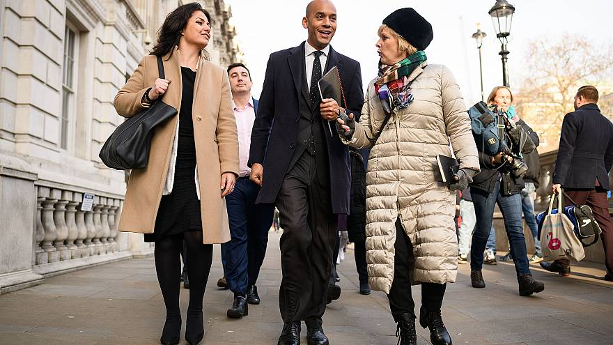Image: Labour MP Chuka Umunna walks with Conservative MPs Heidi Allen, left