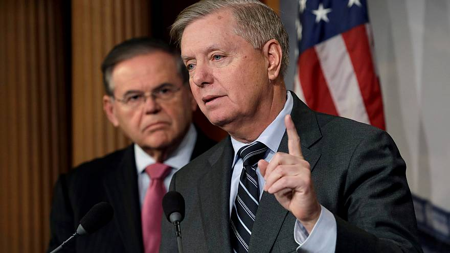 Image: Senators Graham and Menendez hold a news conference on Capitol Hill