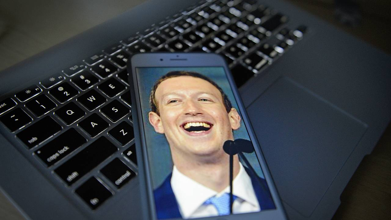 Facebook CEO photo illustration on portable devices